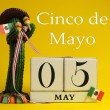 Calendar for Cinco de Mayo May 5, with fun Mexican cactus and flags - Stock Photo