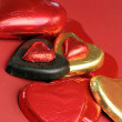 Red and gold heart shape chocolates - vertical close-up. — Stock Photo #19253743