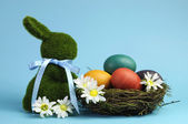 Blue theme Happy Easter still life with grass bunny rabbit with rainbow color eggs in a nest — Photo