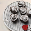 图库照片: Valentine, birthday or special occasion homemade baked heart shape chocolate chip muffins against vintage, shabby chic white wood table.