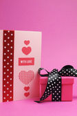 Cute and sassy pink and black polka dot gift with handmade gift card and 'with love' message, for Valentine's Day or special occasion. Vertical portrait orientation. — Stock Photo