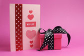 Cute and sassy pink and black polka dot gift with handmade gift card and 'with love' message, for Valentine's Day or special occasion. — Stock Photo