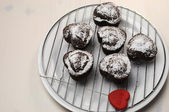 Valentine, birthday or special occasion homemade baked heart shape chocolate chip muffins against a vintage, shabby chic white wood table. — Stock Photo