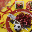 Soccer football celebration party table settings in red and yellow team colors. — Stock Photo