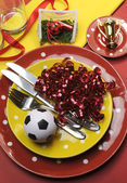 Soccer football celebration party table settings in red and yellow team colors. Vertical portrait orientation, — Stock Photo