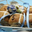 Easter Hot Cross Buns with blue decorations close up. - Stock Photo