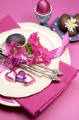 Decorative Happy Easter dinner table setting with boiled and chocolate Easter eggs. Vertical orientation. — Stock Photo