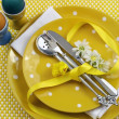 Yellow theme Easter dining table setting with egss, chick and daisies Vertical. — Stock Photo #20533523