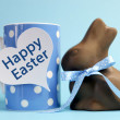 Blue theme polka dot breakfast coffee mug with chocolate bunny rabbit and heart shape message saying Happy Easter. — Stock Photo #20533549