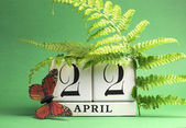Earth Day, save the date white block calendar, April 22, with butterfly and ferns against a green background. — Stock Photo