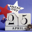 Australian ANZAC Day, April 25, save the date with WW1 Rising Sun Hat Badge on blue background with white calendar and Australian flag. - Stock Photo