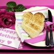 Royalty-Free Stock Photo: Happy Mothers Day breakfast tray with pink rose and heart shape toast on polka dot tray.