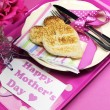 Happy Mothers Day breakfast tray with pink rose and heart shape toast on polka dot tray. Vertical. — Stock Photo #22189997