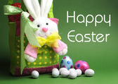 Happy Easter message with Bunny basket and eggs for Easter Sunday egg hunt. — Stock Photo