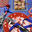 USA Happy Fourth 4th of July party table setting with flags, ribbons, polka dots, and stars and stripes decorations. — Stock Photo