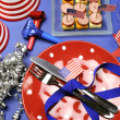 USA Happy Fourth 4th of July party table setting with flags, ribbons, polka dots, and stars and stripes decorations. — Stock Photo #23418934