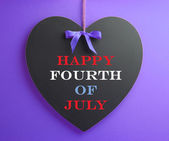 Fourth of July, USA America holiday, celebration with Happy Fourth of July message on heart shape blackboard — Stock Photo