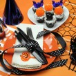Happy Halloween party table with orange polka dot plates and chocolate cupcakes — Stock Photo #23714767