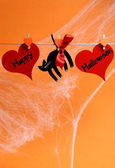 Happy Halloween message written across red hearts and black cat — Stock Photo