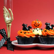 Happy Halloween party food with skeleton hand glass on red background. — Stock Photo