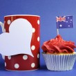 Stock Photo: Australian theme red, white and blue cupcake with national flag and red polka dot coffee mug and white heart tag for your text here, for Australia Day, Anzac Day or national holiday