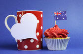 Australian theme red, white and blue cupcake with national flag and red polka dot coffee mug and white heart tag for your text here, for Australia Day, Anzac Day or national holiday — Stock Photo