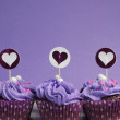 Mauve purple decorated cupcakes for children or teens birthday, or bachelorette, bridal or baby shower party function. Vertical with copy space for your text here. — Stock Photo #24614931