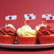 Polish red and white decorated cupcakes with Poland flags for November 11 — Stock Photo #24916189