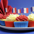 French theme red, white and blue mini cupcake cakes with flags of Franc - Stock Photo