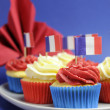 Foto de Stock  : French theme red, white and blue mini cupcake cakes with flags of Franc