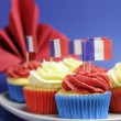 Stock Photo: French theme red, white and blue mini cupcake cakes with flags of Franc