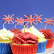 English theme red, white and blue cupcakes with Great Britain Union Jack flag — Stock Photo #24916495