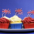 English theme red, white and blue cupcakes with Great Britain Union Jack flags — Stock Photo #24916521