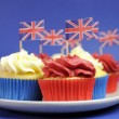 English theme red, white and blue cupcakes with Great Britain Union Jack flags — Stock Photo #24916523