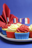 French theme red, white and blue mini cupcake cakes with flags of Franc — Stock Photo