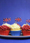 English theme red, white and blue cupcakes with Great Britain Union Jack flags — Stock Photo
