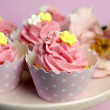 Beautiful pink decorated cupcakes on pink cake stand for birthday, wedding or female special event occasion. Close up with bokeh. — Stock Photo #25422449