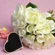 Wedding white roses bouquet with pink cupcake with heart shape blackboard with copy space for your text here. — Stock Photo #25422567