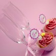 Pink wedding cupcakes with I Do topper signs - with champagne glasses and polka dot ribbon. — Stock Photo #25422721
