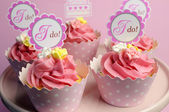 Pink wedding cupcakes with I Do topper signs on pink cake stand - close up. — Stock Photo