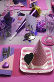Pink and purple theme party table setting decoration, with party hat and plate table setting - vertical.. — Stock Photo
