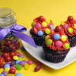 Bright colored candy cupcakes — Stock Photo