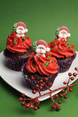 Three Christmas Cupcakes in purple polka dot wrapper with red frosting — Stock Photo