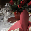 Red and white theme wedding breakfast dining table setting with red table napkins — Stock Photo