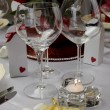 Close up of detail on wedding breakfast dining table setting with wine glasses and candy covered almonds. — Stock Photo #27469681