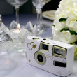 Close up of detail on wedding breakfast dining table setting with wedding camera — Stock Photo #27469811