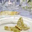 White Satin Wedding Table Setting Detail with gold butterfly — Stock Photo #27469895