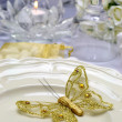 White Satin Wedding Table Setting Detail with gold butterfly — Stock Photo