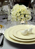 Close up of detail on wedding breakfast dining table setting with dove shape salt and pepper shakers — Stock Photo
