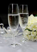 White Satin Wedding Table Setting Detail with champagne flutes — Stock Photo